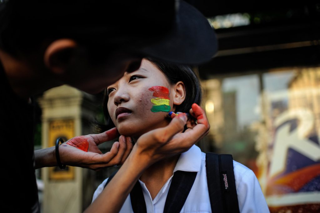 MANILA, PHILIPPINES - JUNE 14: A student activist has her cheek painted in the rainbow colors in solidarity with the victims of the mass shooting at the Pulse nightclub in Orlando, Florida on June 14, 2016 in Manila, Philippines. 49 people were killed after a gunman opened fire at nightclub frequented by gays lesbians and transgender people in the deadliest mass shooting in US history. (Photo by Dondi Tawatao/Getty Images)